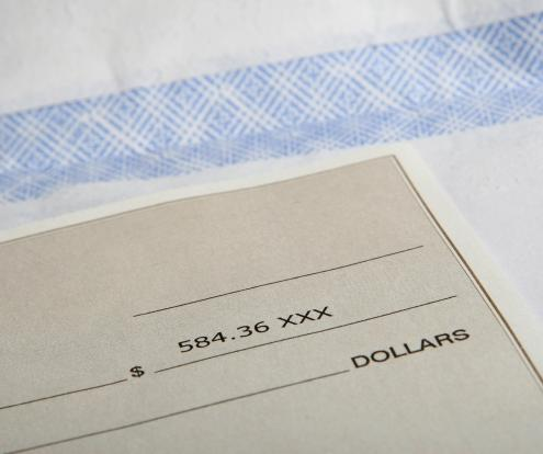 "Checks don't actually expire, although a check that is more than six months old may be considered ""stale."""