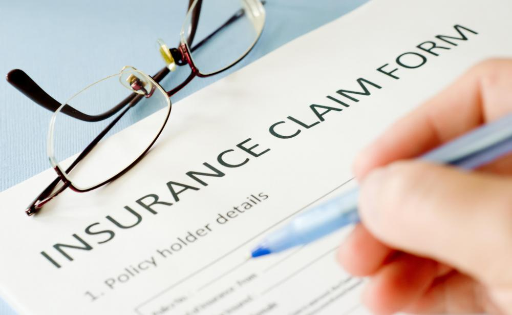 Adjusters review insurance claims.
