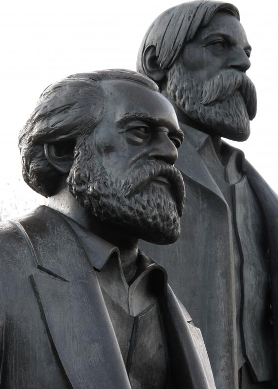 Sculpture of Karl Marx (foreground), a supporter of progressive taxes; and Friedrich Engels.